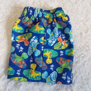 3/$30 OP Surfing Dinosaurs swim trunks size 3-6mos